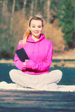 Girl learning yoga from tablet. Royalty Free Stock Photos