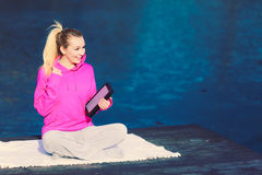 Girl learning yoga from tablet. royalty free stock photography
