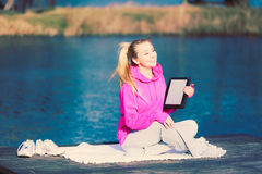 Girl learning yoga from tablet. Stock Photography
