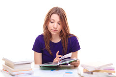 Girl learns from different books Stock Images