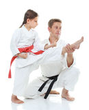 Girl learns to hit a kick dad helps Royalty Free Stock Photography