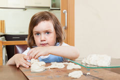 Girl learns to make dough figurines Royalty Free Stock Images