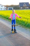 Girl learns to rollerblade Royalty Free Stock Photos