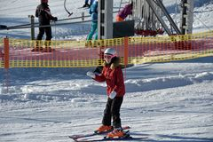 Girl learns to ski with ski instructor royalty free stock photography