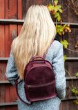 Girl with a leather backpack stock images
