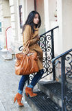 Girl with a leather bag. The nice Asian girl with a leather bag walks upstairs Stock Image