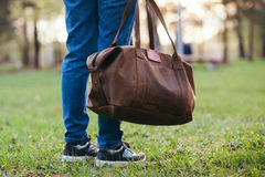 The girl with a leather bag outdoors. Stock Photography