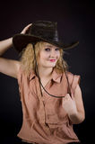 Girl in a leather cowboy hat Stock Photo