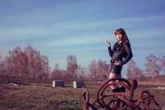 Girl in leather jacket. Beautiful girl in leather jacket on the field royalty free stock images