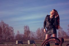 Girl in leather jacket royalty free stock images