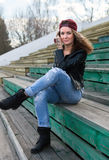 Girl in leather jacket and black boots Royalty Free Stock Photos