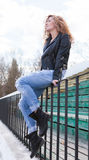 Girl in leather jacket and black boots Royalty Free Stock Image