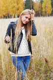 The girl in a leather jacket among  grass Royalty Free Stock Photography
