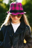 Girl in leather jacket and hat Royalty Free Stock Images
