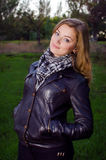 Girl in leather jacket. In the park Royalty Free Stock Photos