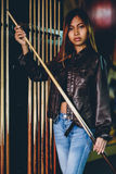 Girl in leather jacket preparing to play billiard. Girl preparing to play billiard Royalty Free Stock Photography