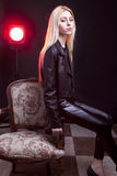 Girl in leather jacket with a red light behind Royalty Free Stock Photos