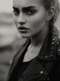 Girl in a leather jacket Royalty Free Stock Photo