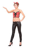 Girl in leather pants and corset. devil horns on Royalty Free Stock Photography