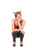 Girl in leather pants and corset. devil horns on Stock Photos