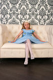 Girl and leather sofa Royalty Free Stock Photography
