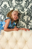 Girl and leather sofa Royalty Free Stock Image