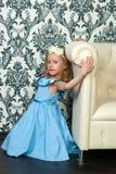 Girl and leather sofa Stock Image
