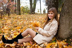 Girl with leaves Royalty Free Stock Images