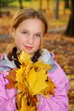 Girl with leaves Royalty Free Stock Image