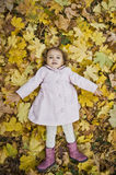 Girl on the leaves Stock Photo