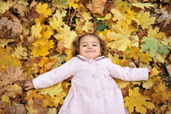 Girl on the leaves Royalty Free Stock Images