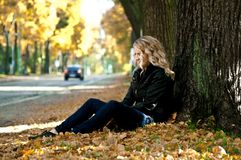 Girl in the leaves stock image