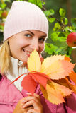 Girl with a leaves. Attractive young girl with a bunch of autumn leaves Royalty Free Stock Photo