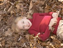 Girl in leaves royalty free stock photos
