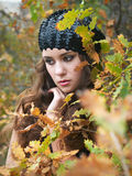Girl at leaves Royalty Free Stock Images