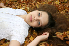 Girl in leaves Stock Images