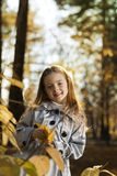 Girl in leaves autumn Stock Photography