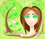 Girl with leaves eyes, in the garden. Girl with leaves on the face, in the lush spring garden Royalty Free Stock Photo