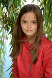 Girl in the leaves of a weeping willow Royalty Free Stock Photos