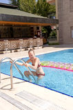 Girl leaving a swimming pool stock photos
