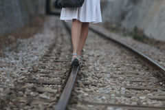 Girl leaving walking over rails. A girl walks over the railway path near the village of bunyola, in the Spanish island of Mallorca Royalty Free Stock Images