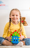 Girl with lego house Stock Images
