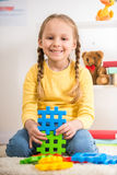 Girl with lego Stock Photography