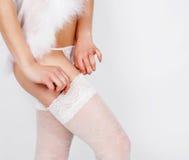 Girl legs in erotic white dress Stock Photos