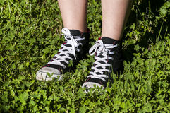 Girl legs with sneakers Stock Photography