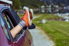 Girl legs sticking out of the car Stock Photography