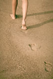 Girl  legs, walking on the beach Royalty Free Stock Photo