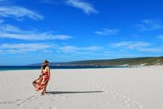 Girl on leisure walk on beach stock image