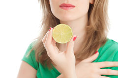 Girl with a lemon. Beautiful woman with a lemon in a white background Royalty Free Stock Image
