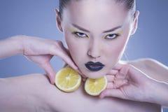 Girl with Lemon. Beautiful, young girl portrait - holding lemon Royalty Free Stock Photography